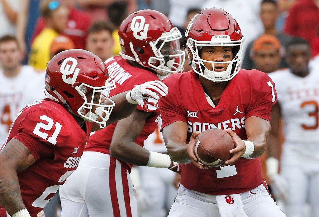 Oklahoma Sooners quarterback Kyler Murray (1) and Oklahoma Sooners running back Marcelias Sutton (21) are pictured during the University of Texas Longhorns vs. the Oklahoma Sooners NCAA football game at the Cotton Bowl in Dallas on Saturday, October 6, 2018. (Louis DeLuca/The Dallas Morning News)