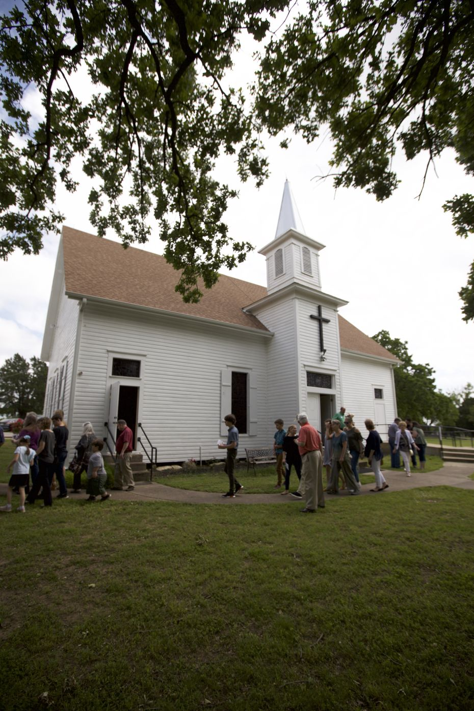 Churchgoers file out of College Mound United Methodist Church to enjoy the 2019 Decoration Day feast. Members of the community 40 miles east of Dallas have honored their ancestors with grave-site flowers and a feast in a tradition that dates back 134 years.