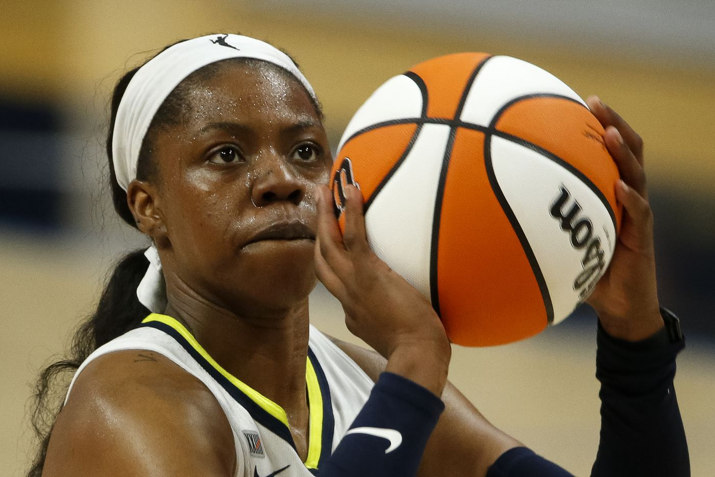 Dallas Wings guard Arike Ogunbowale (24) attempts a free throw during the fourth quarter against the Washington Mystics at College Park Center on Saturday, June 26, 2021, in Arlington. (Elias Valverde II/The Dallas Morning News)