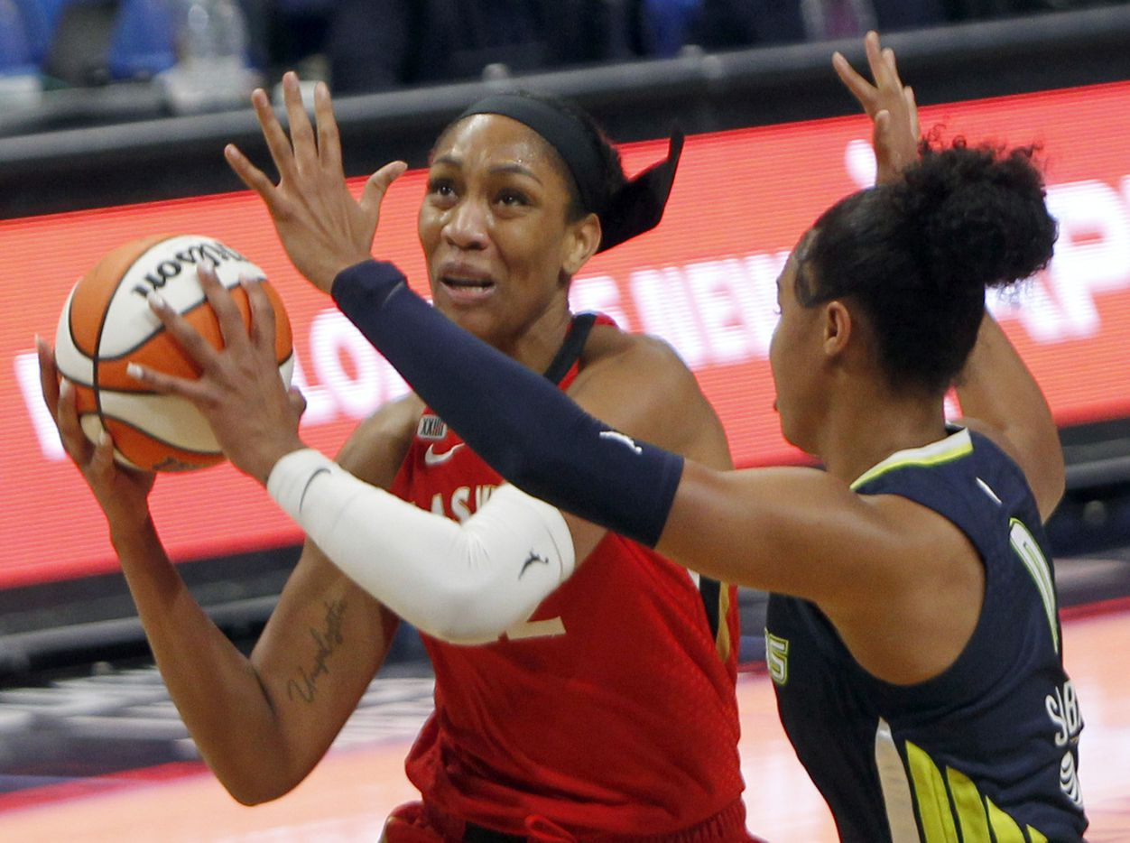 Las Vegas forward A'ja Wilson (22) looks to shoot as she is defended by Dallas Wings forward Satou Sabally (0) during first half action. The two WNBA teams played their game at College Park Center on the campus of UT-Arlington on July 11, 2021. (Steve Hamm/ Special Contributor)