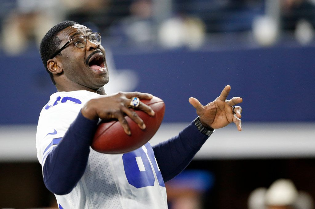Dallas Cowboys former receiver Michael Irvin (88) plays catch with himself after being introduced before a game against the Philadelphia Eagles at AT&T Stadium in Arlington, Texas on Sunday, November 19, 2017. (Vernon Bryant/The Dallas Morning News)