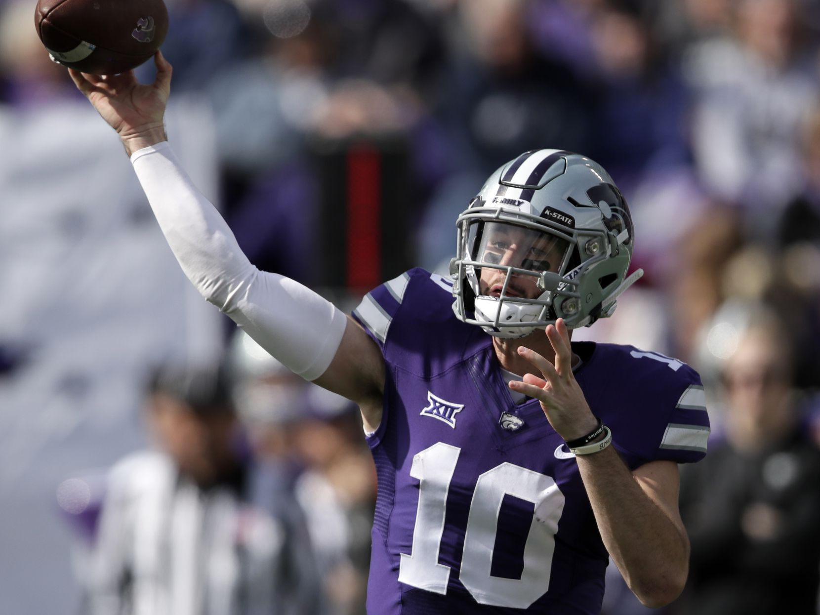 FILE - Kansas State quarterback Skylar Thompson (10) passes to a teammate during the first half of an NCAA college football game against Oklahoma State in Manhattan, Kan., Saturday, Oct. 13, 2018. (AP Photo/Orlin Wagner)