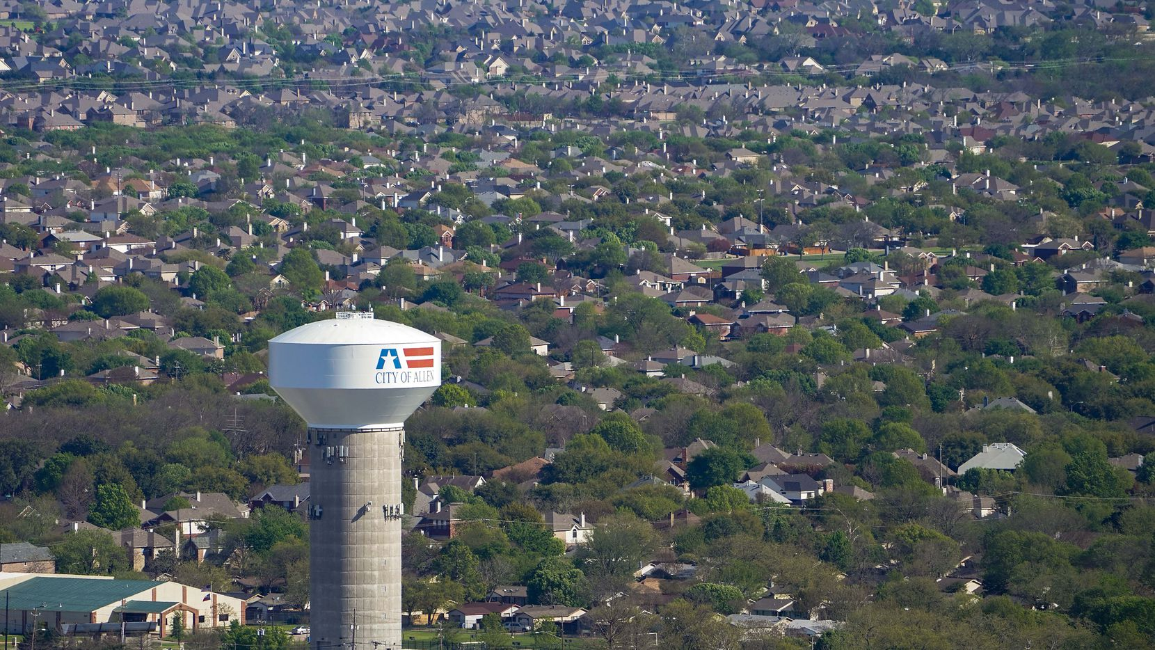 Aerial view of water tower and residential neighborhood in Allen, Texas on Tuesday, March 24, 2020.