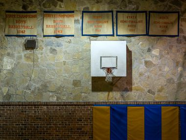 The banners from Slidell High School's 1942 and 1943 state championships hand on the wall of the school's old gymnasium on Tuesday, March 5, 2019, in Slidell, Texas. Slidell High School, northwest of Denton, is trying to win its first state boys basketball title since 1943. The school does not play football. (Smiley N. Pool/The Dallas Morning News)