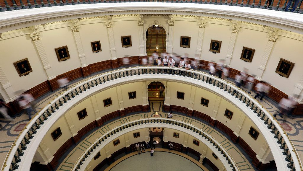 Visitors move though the rotunda at the Texas Capitol, Thursday, June 15, 2017, in Austin, Texas.