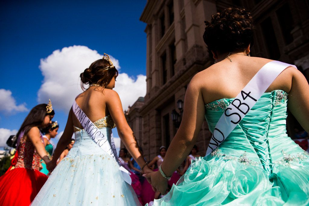 Teenage girls with Jolt Texas hold symbolic quinceaneras to protest the sanctuary cities ban on Wednesday, July 19, 2017 outside the Texas state capitol in Austin, Texas. (Ashley Landis/The Dallas Morning News)