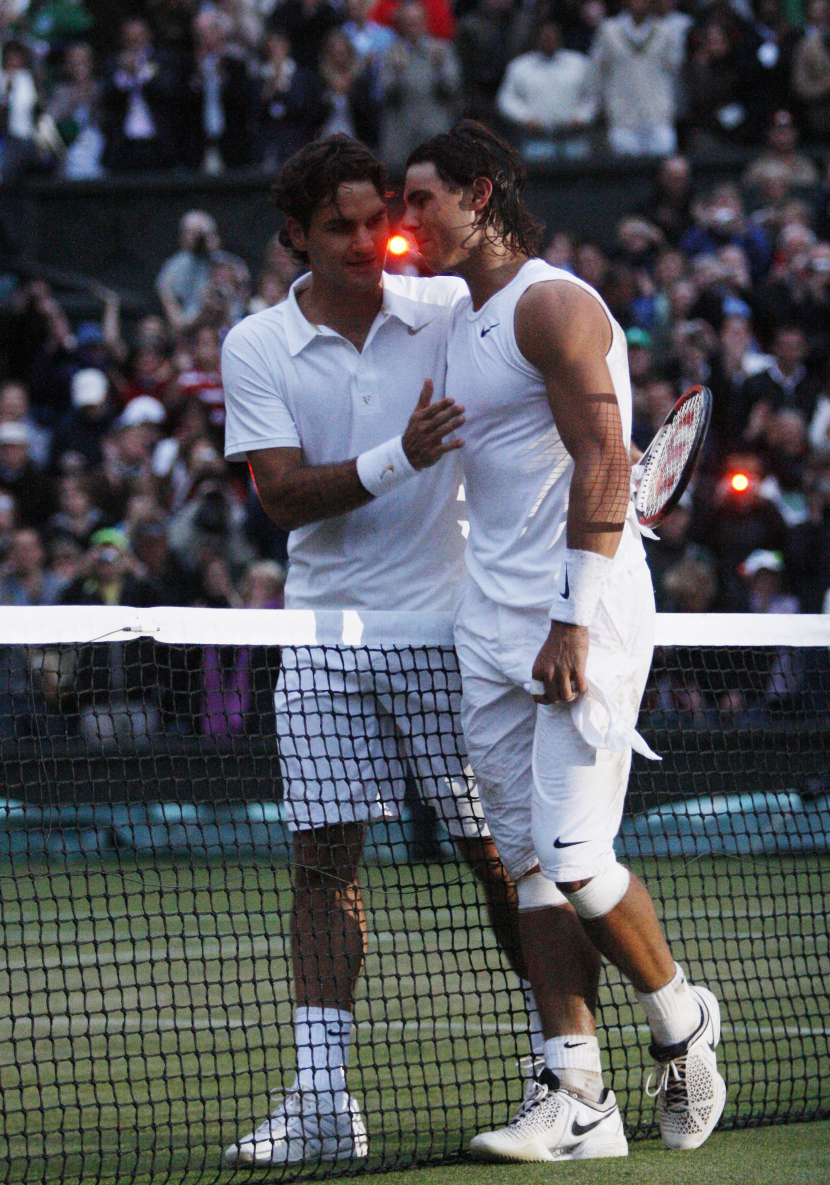 Spain's Rafael Nadal (R) is congratulated by Switzerland's Roger Federer after winning their final tennis match of the 2008 Wimbledon championships against  at The All England Tennis Club in southwest London, on July 6, 2008. Nadal won 6-4, 6-4, 6-7, 6-7, 9-7.