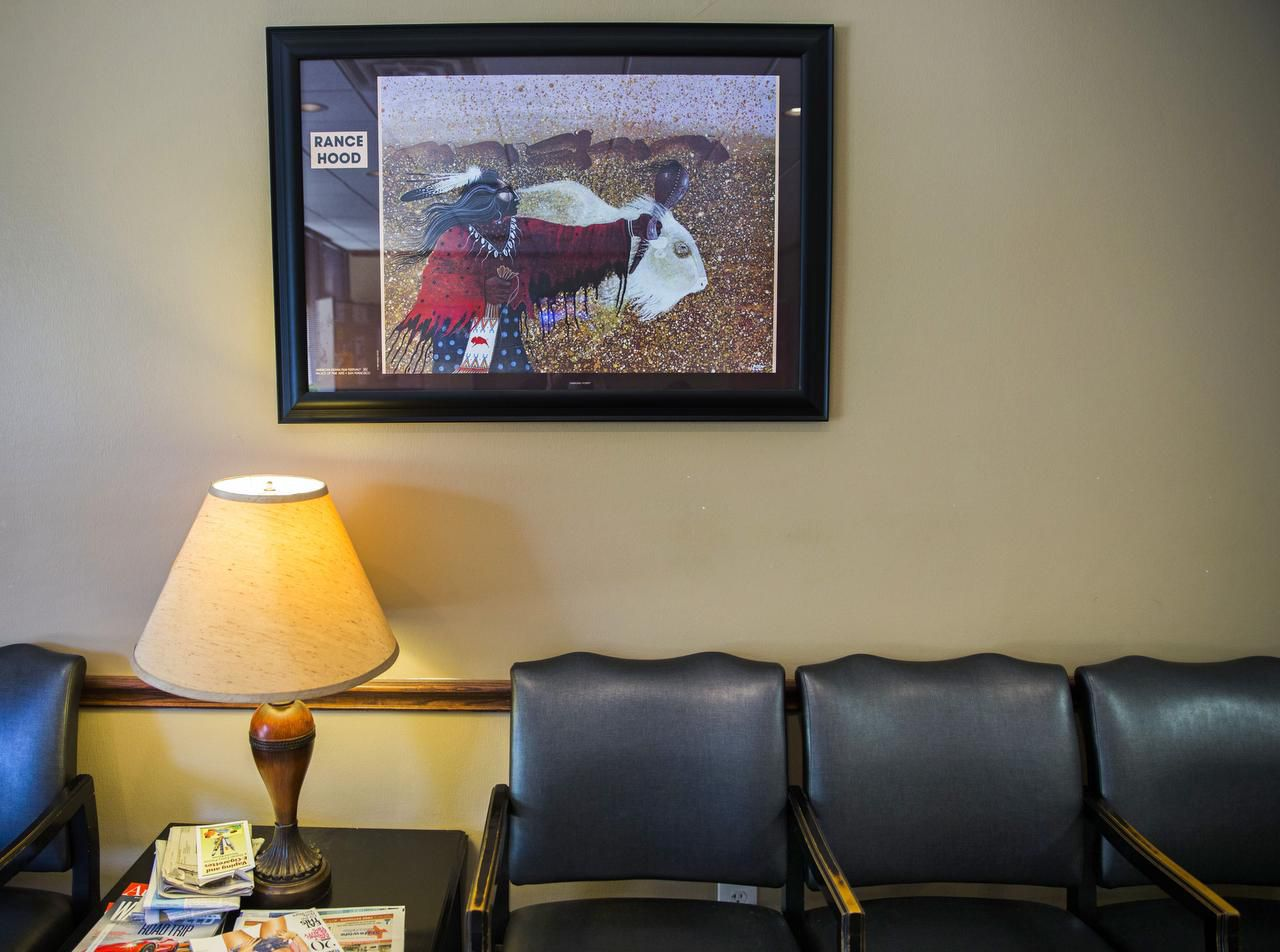 Artwork by regional  American Indian artists,  such as Rance Hood, decorates the waiting room of the Urban Inter-Tribal Center of Texas.
