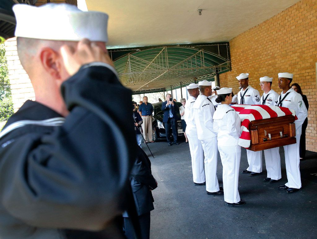 The remains of Navy Seaman 1st  Class (E3) George A. Coke Jr. of Arlington are carried into Moore Funeral Home by members of the NAS JRB Navy Honor Guard after they arrived on a commercial flight at Dallas-Fort Worth International Airport, Friday, June 23, 2017. Coke, who perished in the USS Oklahoma after it sank at Pearl Harbor, was identified through recent DNA testing. The North Texas Patriot Guard Riders joined the procession to Moore Funeral Home in Arlington. A service for Coke will be held at First United Methodist Church in central Arlington Saturday before being buried at Parkdale Cemetery.
