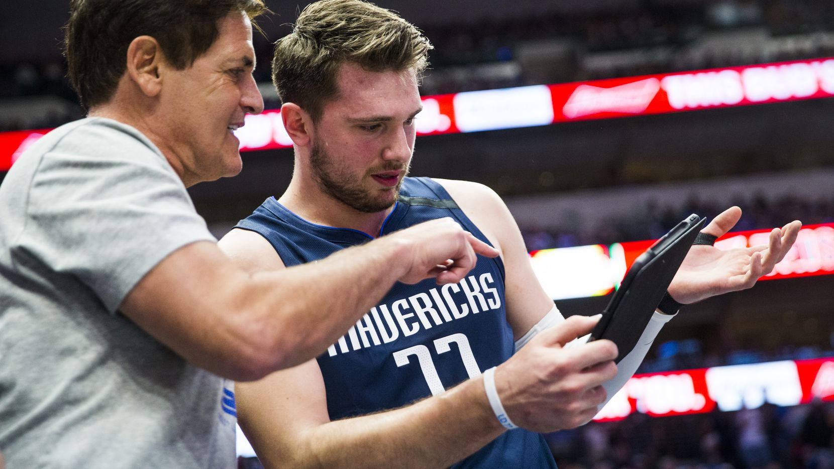 FILE - Mavericks guard Luka Doncic (77) looks at a play with Mavs owner Mark Cuban during the first quarter of a game against the Pacers on Sunday, March 8, 2020, at American Airlines Center in Dallas.