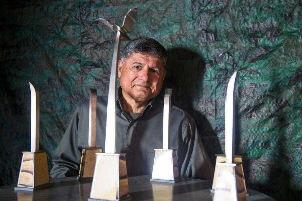 U.S. Army veteran and sculptor Eliseo Garcia poses for a photograph with a model of the future sculpture near the banks of the Trinity River at his studio in Dallas on Nov. 15, 2018. Garcia was selected for a $75,000 city-funded commission to design and install a sculpture.