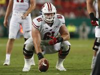 FILE - Wisconsin center Tyler Biadasz (61) is pictured during a game against South Florida on Friday, Aug. 30, 2019 in Tampa, Fla. (AP Photo/Mark Lomoglio)