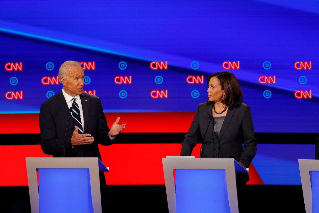 Former Vice President Joe Biden, and Sen. Kamala Harris, D-Calif. participate in the second of two Democratic presidential primary debates hosted by CNN, July 31, 2019, in the Fox Theatre in Detroit.