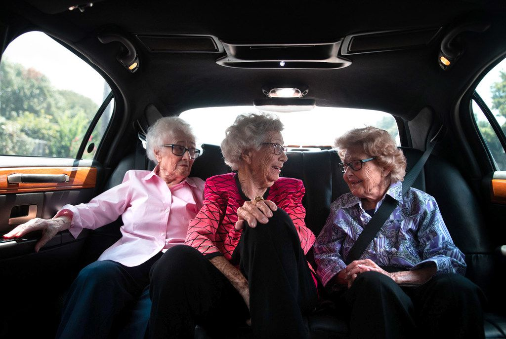 """From left, Emily Spaniel, 96, Hazel Bankston, 103, and Agnes """"Mickey"""" Santillo, 99, ride a limousine to El Fenix restaurant on Monday, Sep. 9, 2019, in Dallas. The trip was part of Santillo's final wish since she entered into Hospice care in May. El Fenix is a special restaurant for Santillo, and it is where her and family have celebrated many milestones at the restaurant over the years. (Lynda M. Gonzalez/The Dallas Morning News)"""