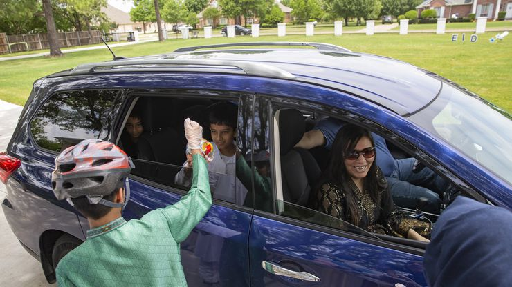 The Usmani family drives by Abdul Hayee and Qudsia Nadeem Eid celebration on Sunday in Plano.