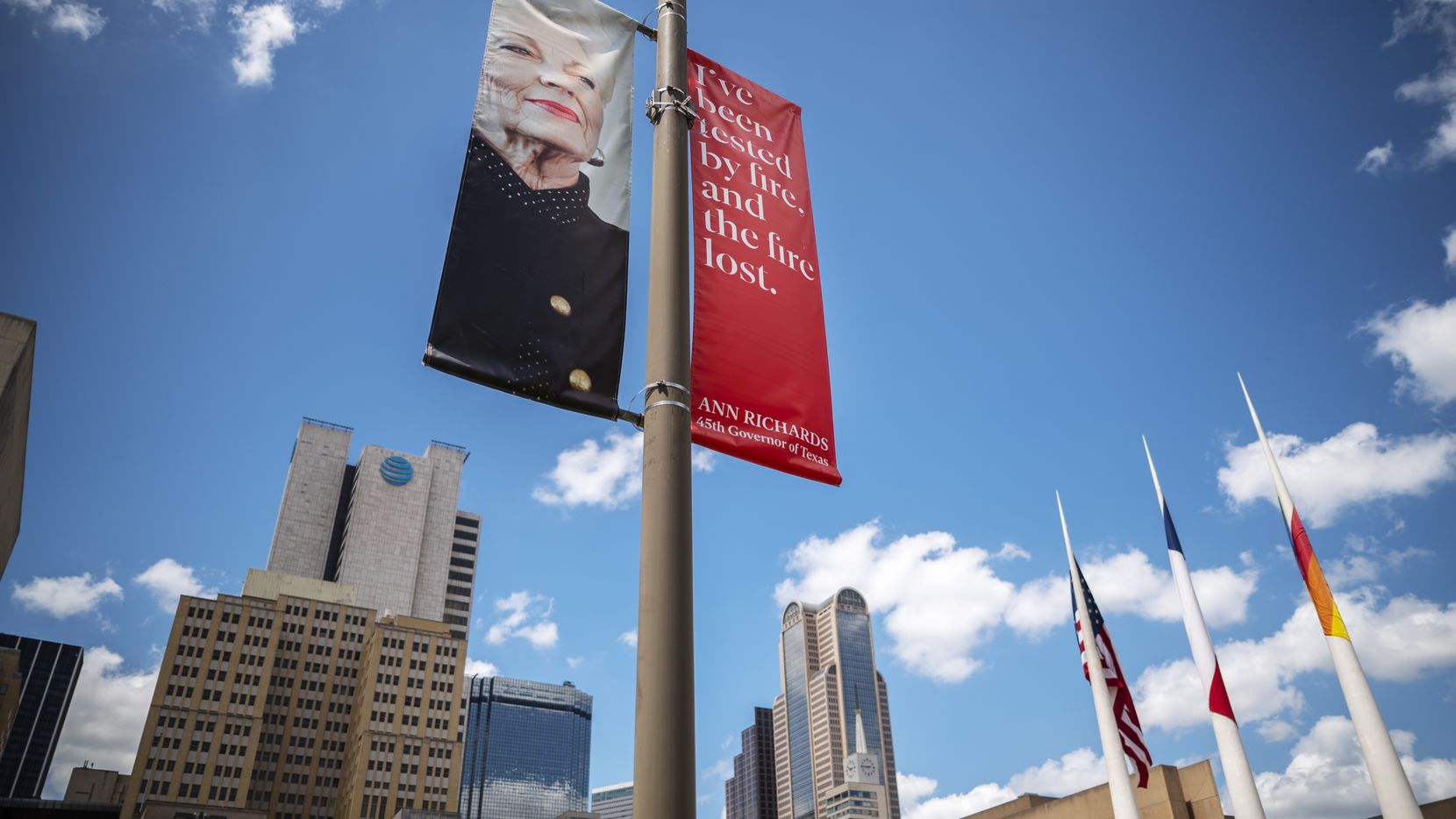 About 60 banners in downtown Dallas show 12 different designs featuring photos and quotes from Ann Richards, marking the 30th anniversary of her inauguration.