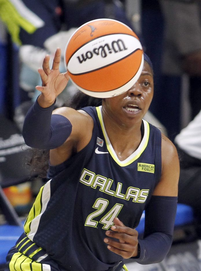 Dallas Wings guard Arike Ogunbowale (24) reaches to pull in a pass from a teammate during first half action against the Chicago Sky. The two WNBA teams played their game at College Park Center in Arlington on June 30, 2021. (Steve Hamm/ Special Contributor)