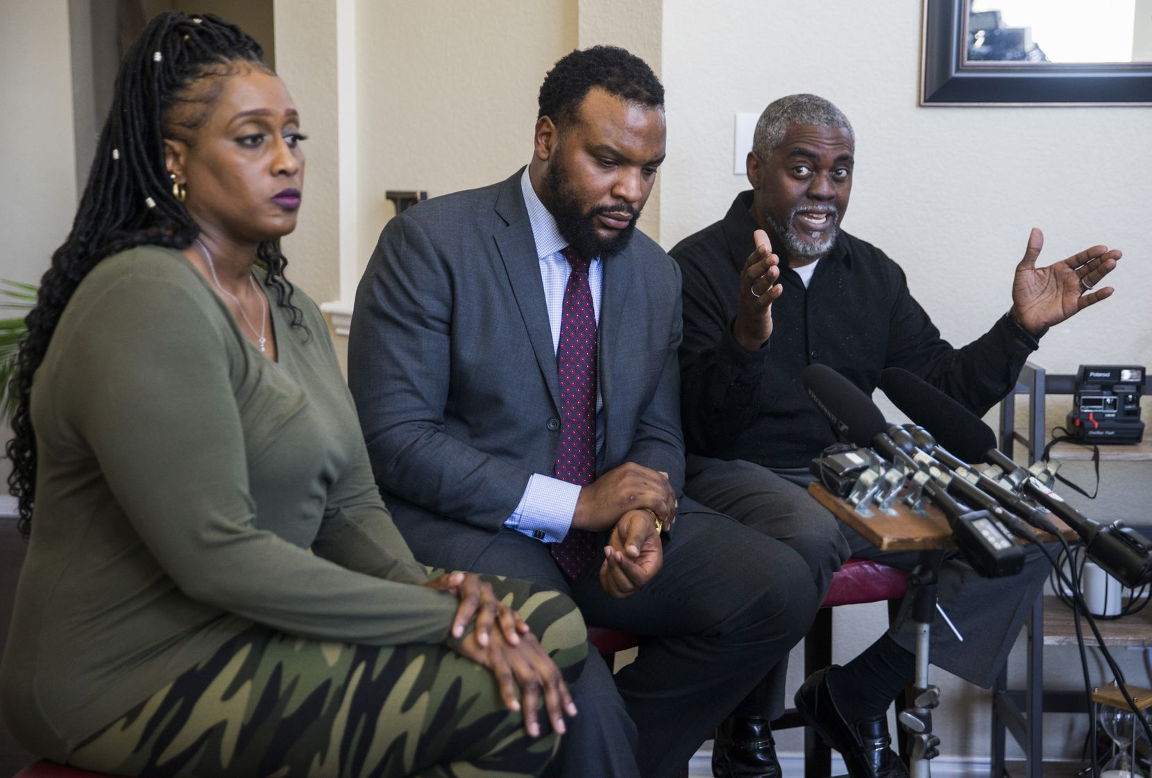 Attorney Lee Merritt (center) and the parents of Darius Tarver, Froncella Reece (left) and Kevin Tarver, speak to reporters at Merritt's home on Friday, March 6, 2020 in McKinney. Tarver, a UNT student was killed by Denton police in January. (Ashley Landis/The Dallas Morning News)