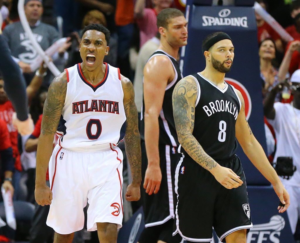 The Atlanta Hawks' Jeff Teague (0) reacts after hitting a shot against the Brooklyn Nets' Brook Lopez and Deron Williams (8) in the final minutes of a 107-97 victory in Game 5 of the Eastern Conference quarterfinals at Philips Arena in Atlana on Wednesday, April 29, 2015. The Hawks now lead the series, 3-2. (Curtis Compton/Atlanta Journal-Constitution/TNS) 04302015xSPORTS