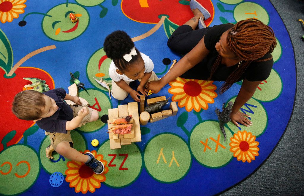 Antonio Tejedor (left), Caydance Jones (center) and instructor Yashekia Mitchell construct a pen for their zoo animals at CP Preparatory School in Mesquite. Mesquite ISD is dipping deeper into early intervention by partnering with day cares to provide free pre-K for qualifying 3-year-olds. CP Preparatory School is one of seven pilot sites for the fall.