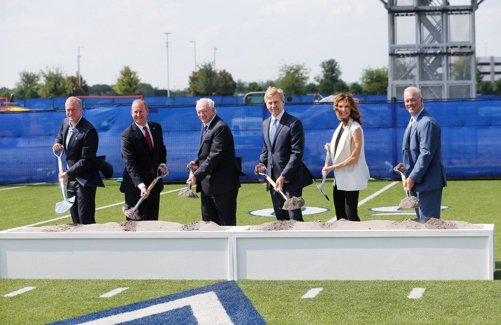 From left: Dallas Cowboys executive vice president Jerry Jones Jr., Frisco Mayor Jeff Cheney, Dallas Cowboys owner and general manager Jerry Jones, Keurig Dr Pepper chairman and CEO Bob Gamgort, Dallas Cowboys executive vice president Charlotte Jones Anderson and Dallas Cowboys executive vice president Stephen Jones shovel dirt during a groundbreaking of Keurig Dr Pepper's new headquarters at The Star in Frisco on Thursday.