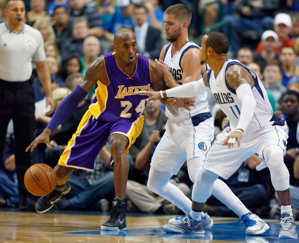 DALLAS, TX - NOVEMBER 21: Kobe Bryant #24 of the Los Angeles Lakers moves the ball against Chandler Parsons #25 of the Dallas Mavericks and Monta Ellis #11 of the Dallas Mavericks in the first quarter at American Airlines Center on November 21, 2014 in D