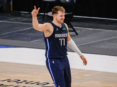 Dallas Mavericks guard Luka Doncic (77) smiles after defeating the Los Angeles Lakers at the American Airlines Center on Saturday, April 24, 2021, in Dallas. (Juan Figueroa/The Dallas Morning News)