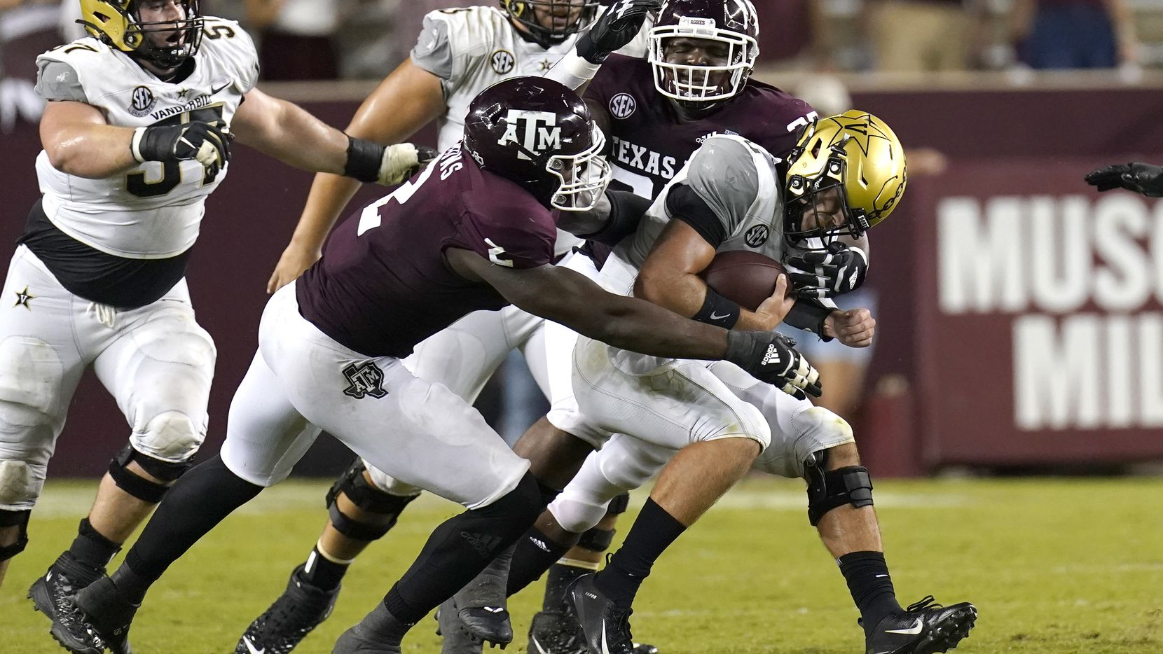 Vanderbilt quarterback Ken Seals, right, is sacked by Texas A&M's Micheal Clemons (2) McKinnley Jackson during the second half of an NCAA college football game Saturday, Sept. 26, 2020, in College Station, Texas. Texas A&M won 17-12.