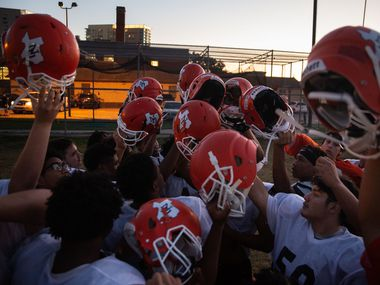 The North Dallas High School varsity football team players huddle together following their after-school practice in the Uptown neighborhood of Dallas on Monday, Nov. 9, 2020. North Dallas has made the playoffs for the first time since 1952 — by far the longest streak among area teams.