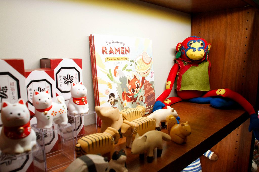 Shelf of children's toys for sale in The Lotus Shop gift shop at the Crow Museum of Asian Art