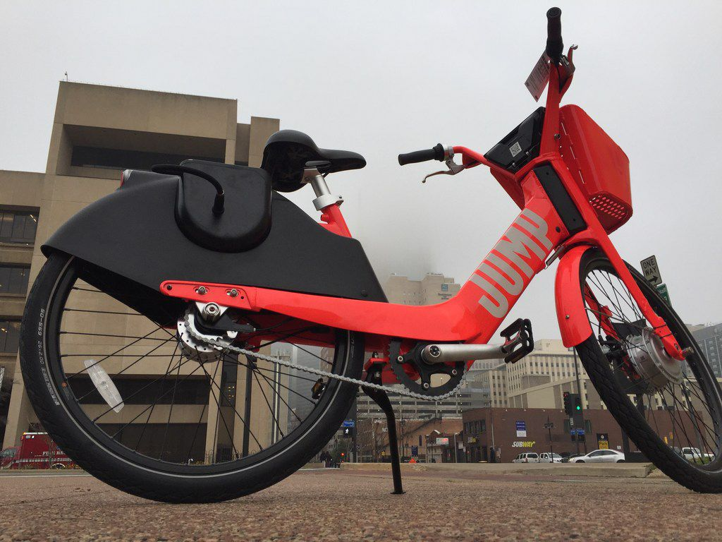 JUMP rechargeable electric bikes sit on the corner of Young and South Ervay streets near Dallas City Hall on Jan. 16, 2019, in Dallas, Texas. JUMP, which Uber bought in April of 2018 for $200 millions, will also have 2,000 Jump-branded electric scooters on the streets of Dallas.
