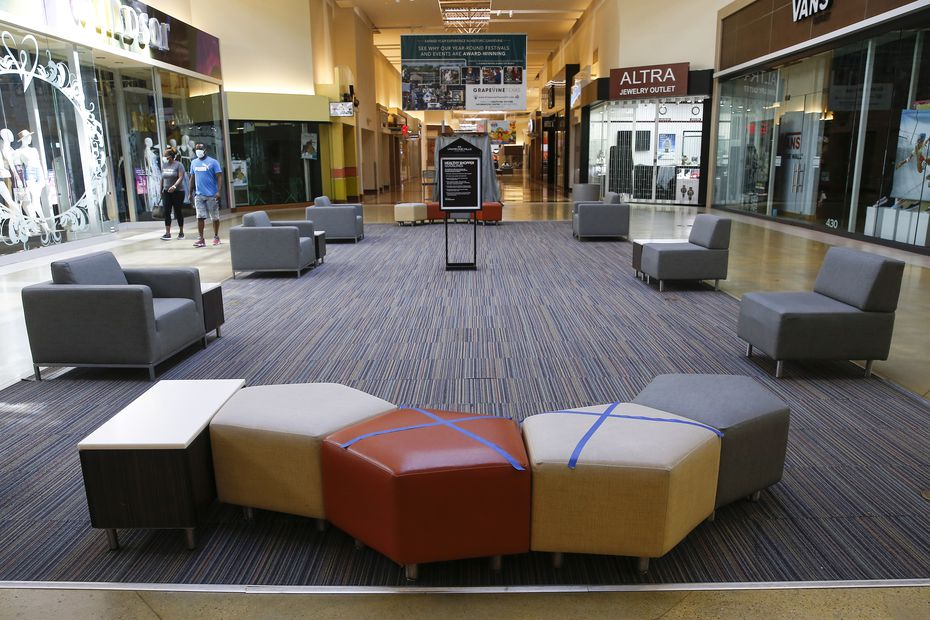 Some seats were marked off as closed to encourage social distancing at Grapevine Mills on Friday.