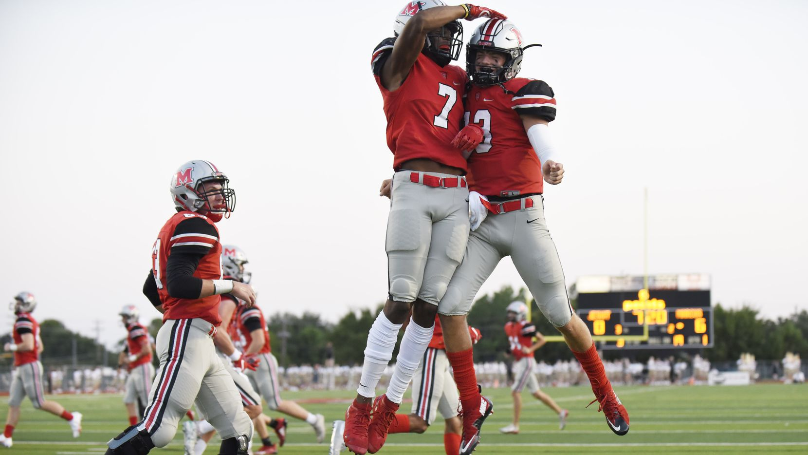 Flower Mound Marcus senior wide receiver J. Michael Sturdivant (7) celebrates with senior quarterback Garrett Nussmeier (13) after the two players connected for the first touchdown of the game versus Jesuit high school, on Friday night, Sept. 25, 2020 at Marauder Stadium in Flower Mound.
