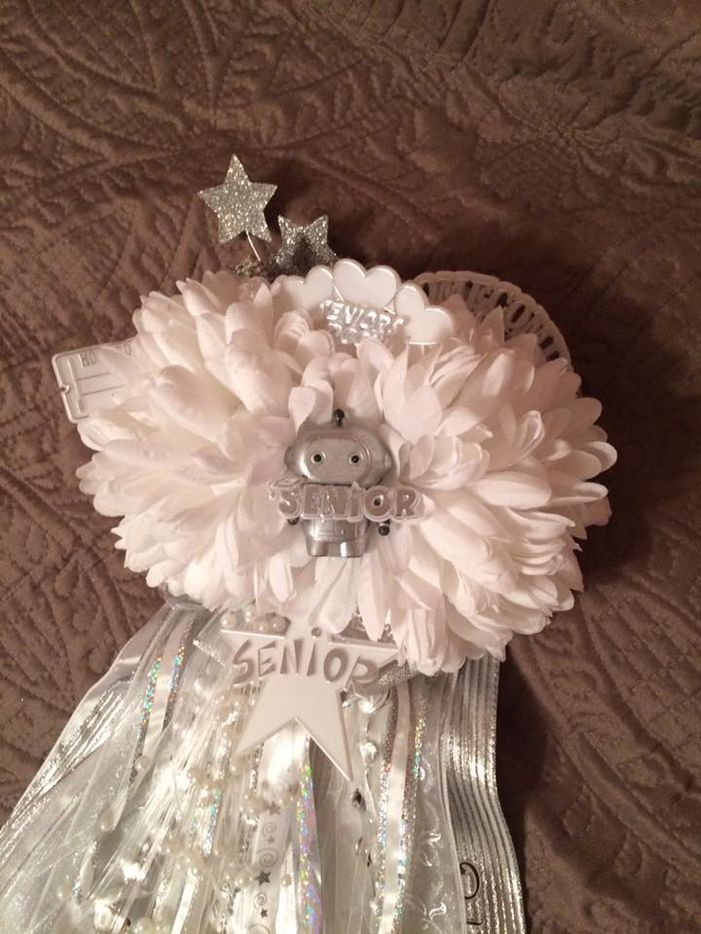 Paige Greenawalt-Hernandez made three of her daughter's four homecoming mums. This one included a robot that moved, lit up and made noise, controlled by a remote that was pinned in the pocket of her letterman jacket.