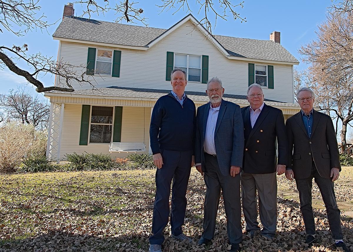 David Stewart (left), Grapevine Mayor William Tate, Scott Tarwater and Peter B. Stewart stand outside the historic home.