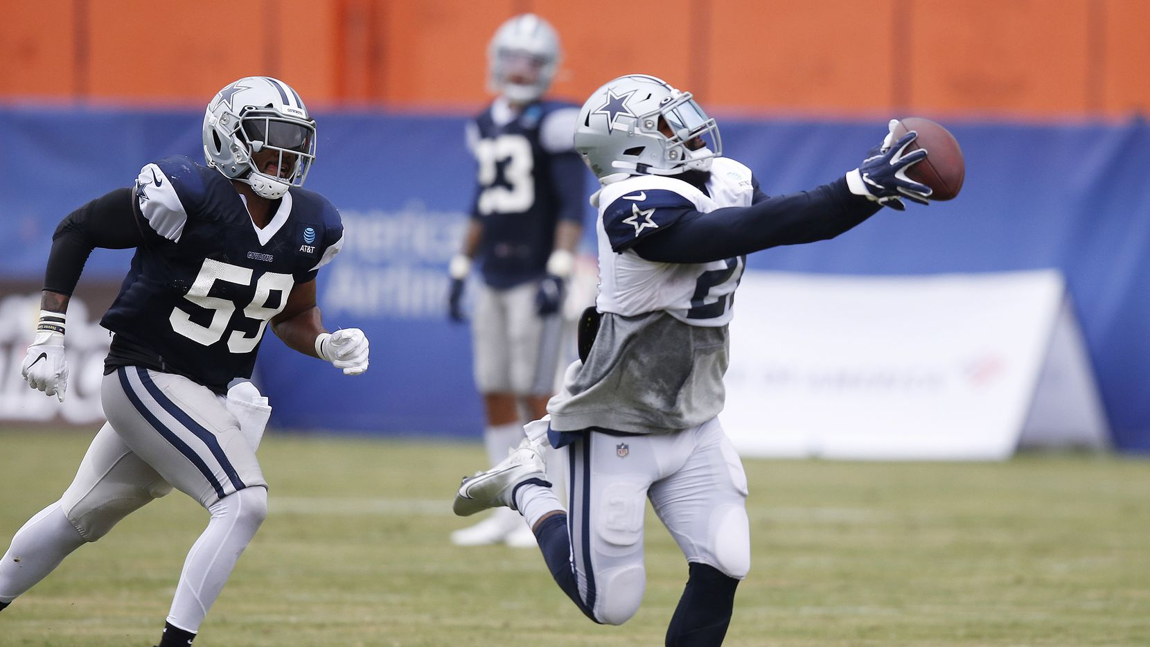 Dallas Cowboys running back Ezekiel Elliott (21) catches a pass in front of Dallas Cowboys linebacker Justin March (59) on a play in practice during training camp at the Dallas Cowboys headquarters at The Star in Frisco, Texas on Thursday, September 3, 2020.