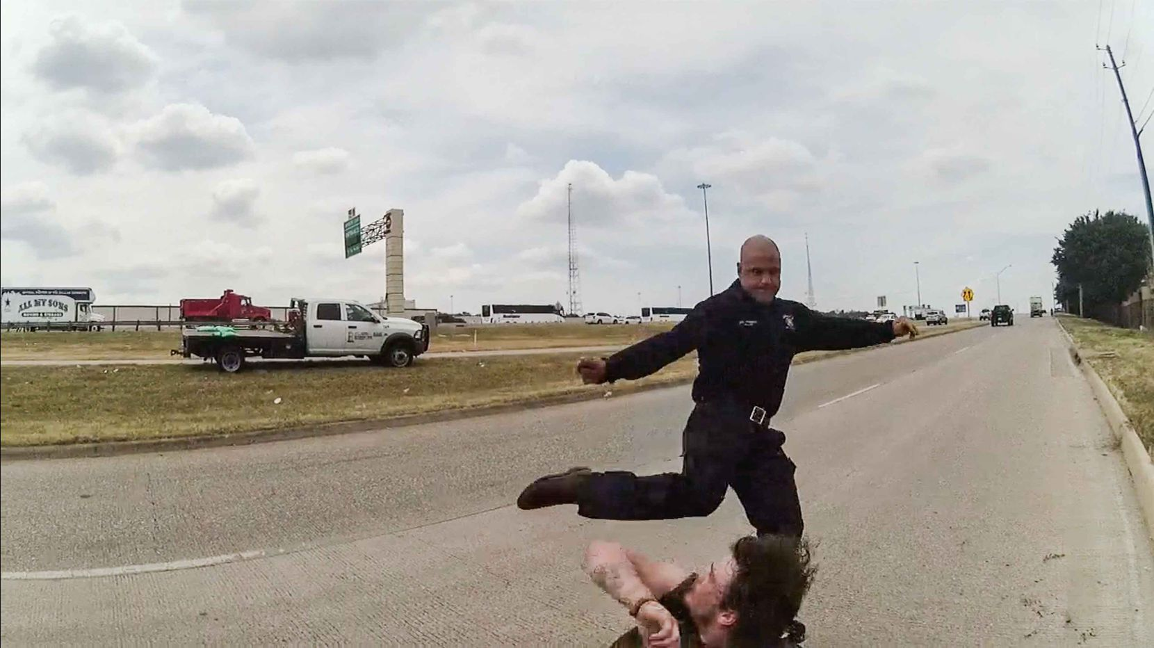 A frame from a police body cam showing  Dallas firefighter Brad Cox during an altercation with Kyle Robert Vess on August 2, 2019.