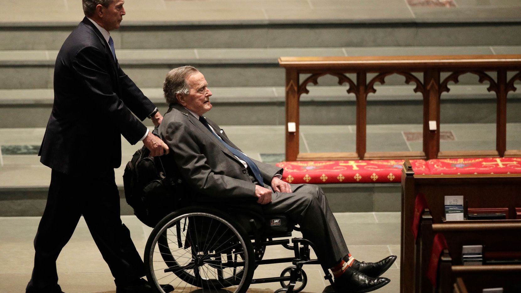 Former presidents George W. Bush and George H.W. Bush arrive at St. Martin's Episcopal Church for the funeral service for former first lady Barbara Bush in Houston.