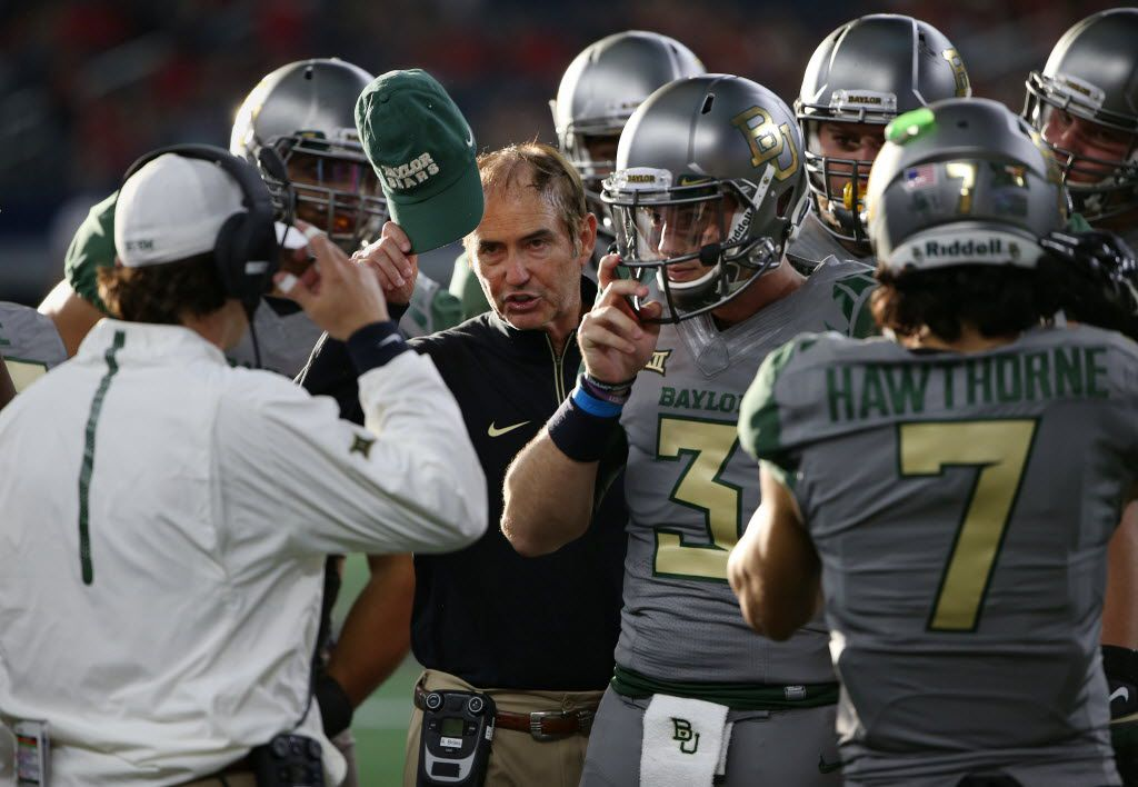 Baylor Bears head coach Art Briles speaks to players in the second half during an NCAA football game between Texas Tech and Baylor at AT&T Stadium in Arlington, Texas Saturday October 3, 2015. (Andy Jacobsohn/The Dallas Morning News)