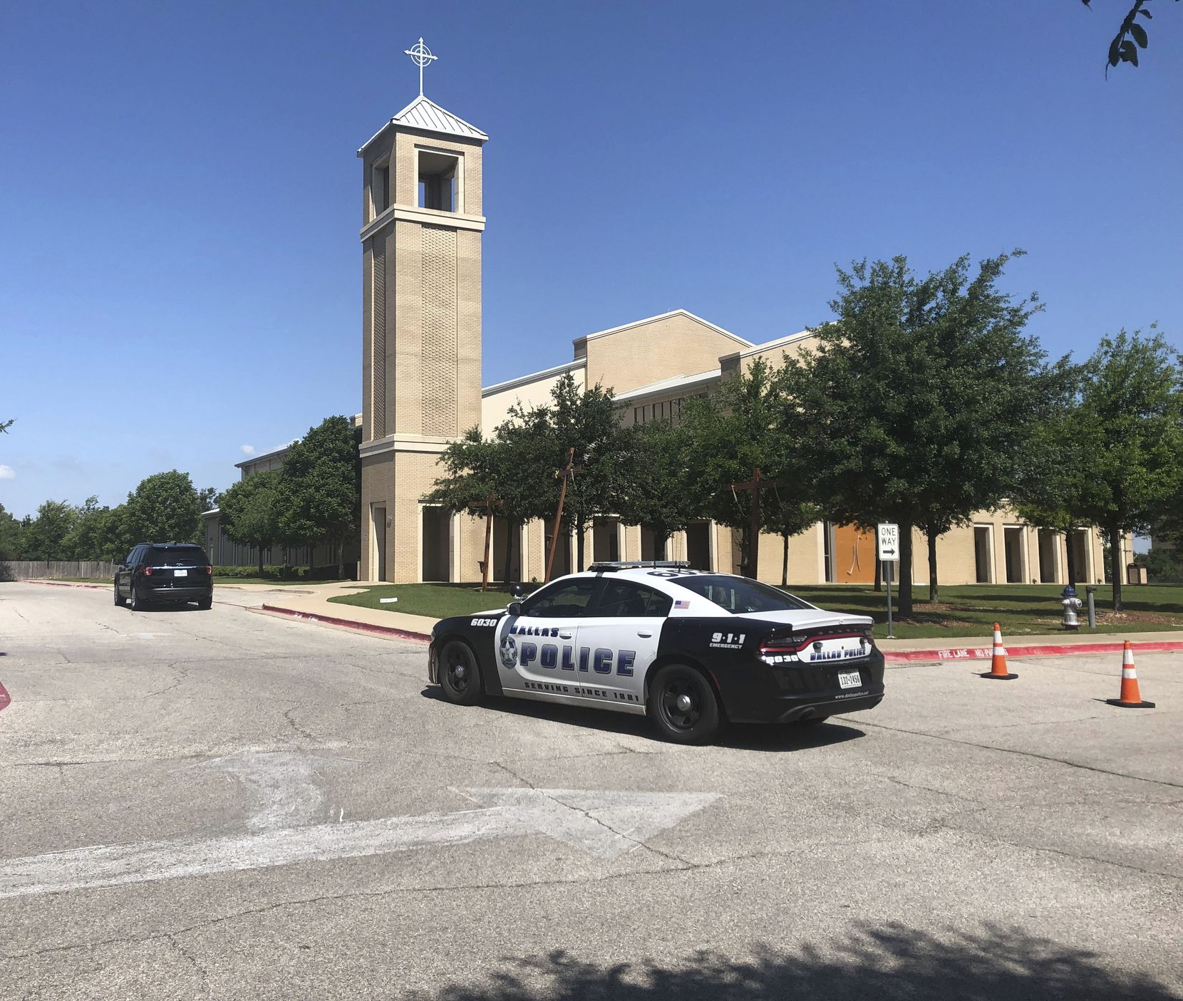 A Dallas Police vehicle outside St. Cecilia Catholic Church in Dallas on Wednesday. Dallas police officers raided several Dallas Catholic Diocese offices after a detective said church officials have not cooperated with investigations into sexual abuse by its past clergy members.
