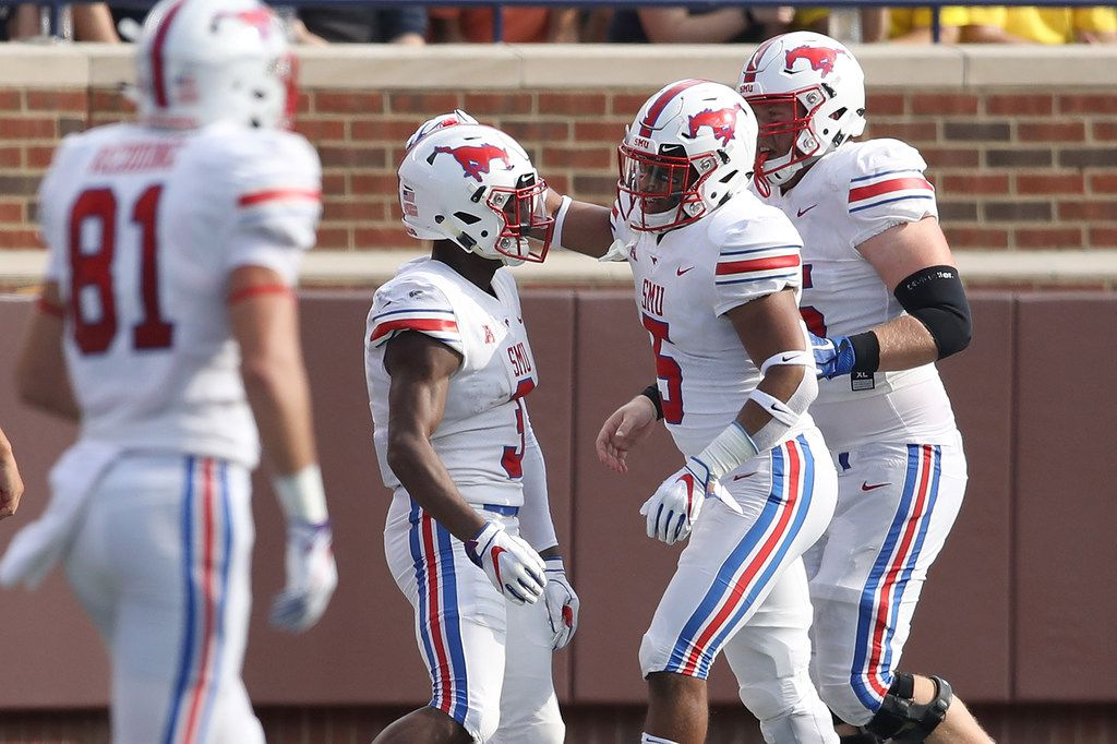 ANN ARBOR, MI - SEPTEMBER 15: James Proche #3 of the Southern Methodist Mustangs celebrates a first half touchdown with teammates while playing the Michigan Wolverines on September 15, 2018 at Michigan Stadium in Ann Arbor, Michigan. (Photo by Gregory Shamus/Getty Images)