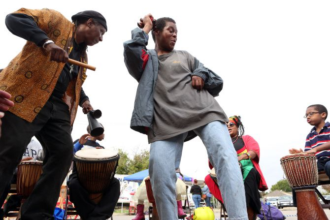 """""""Where there are no roots, there are no fruit,"""" said Clarence E. Glover Jr. (left), shown in a drum circle at the 2019 Harambee Dallas Festival at the Martin Luther King Jr. Community Center. """"We as African-Americans must recognize our historical and cultural roots in order to produce quality and cultural fruit."""""""