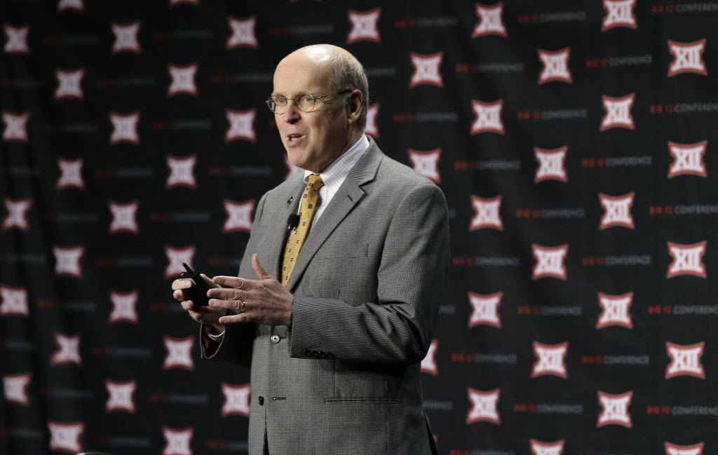 College Football Playoff executive director Bill Hancock speaks at Big 12 college football media days Tuesday in Dallas. (AP Photo/LM Otero)
