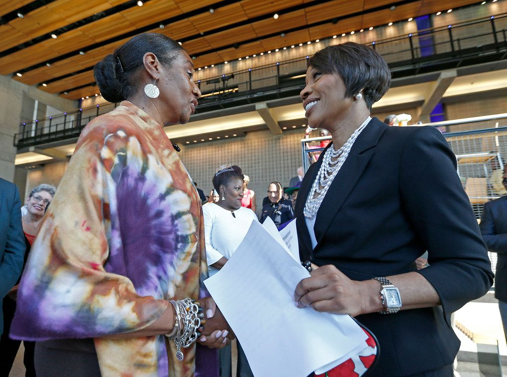 Dallas Police Chief U. Renee Hall (right) shakes hands with Regina Joseph during a meet-and-greet reception organized by the city and the Dallas Police Department at Moody Performance Hall on Sept. 25, 2017.