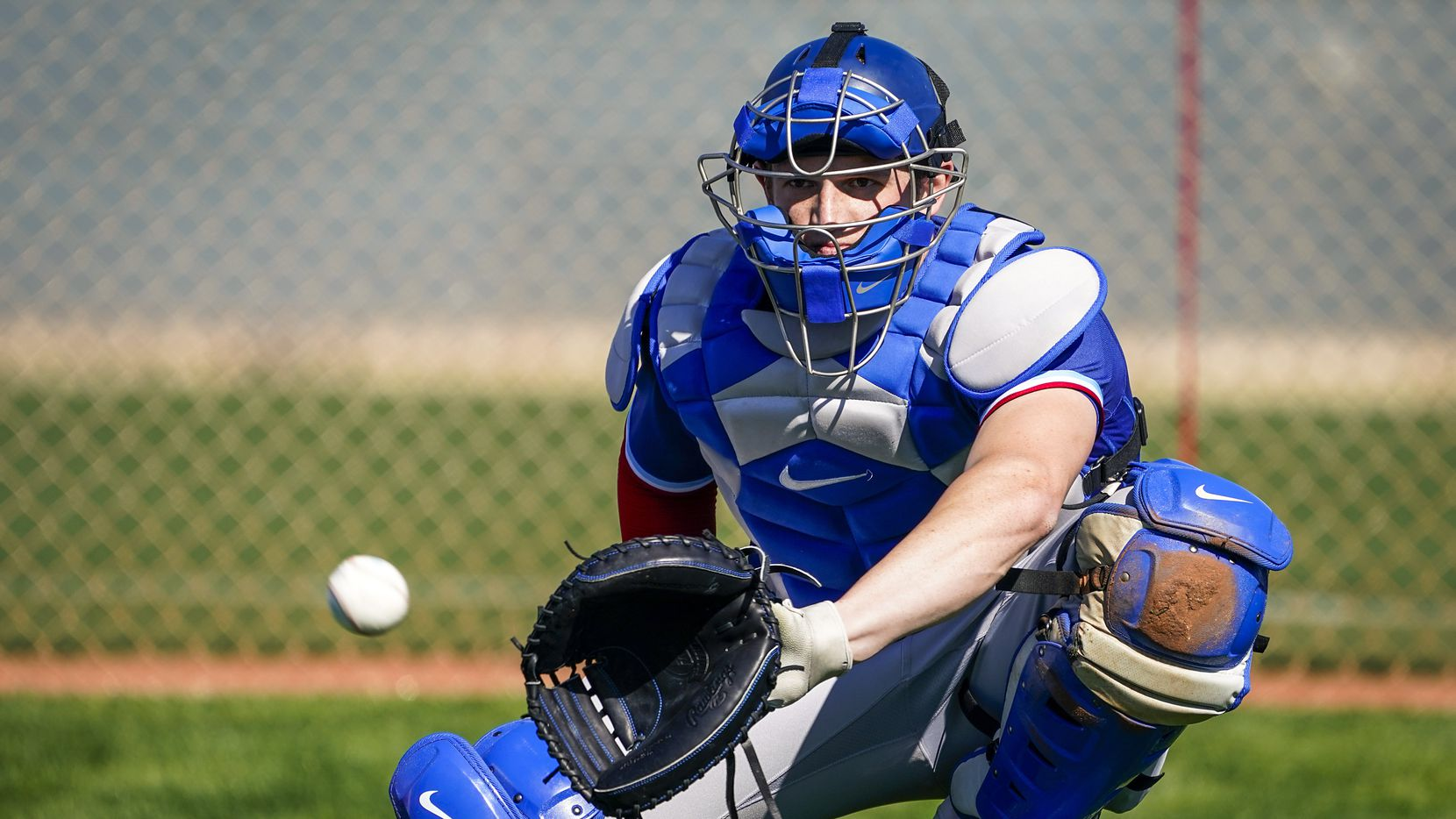 Texas Rangers catcher Sam Huff participates in a drill during a spring training workout at the team's training facility on Saturday, Feb. 15, 2020, in Surprise, Ariz.