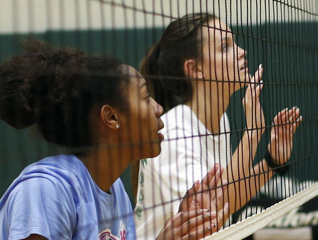 Kennedale varsity volleyball teammates Alex Youngblood, left, and Bryley Steinhilber wait defensively at the net during a practice session. Under the direction of head coach Kelly Carl, the team conducted their first practice of the season at Kennedale High School in Kennedale on August 03, 2020.(Steve Hamm/ Special Contributor)