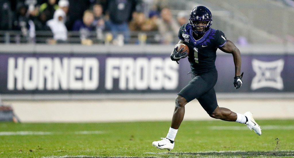 TCU Horned Frogs wide receiver Jalen Reagor (1) takes long stride as he breaks away for a long  punt return for a touchdown against the West Virginia Mountaineers at Amon G. Carter Stadium in Fort Worth, Friday, November 29, 2019. The Horned Frogs lost though, 20-17.