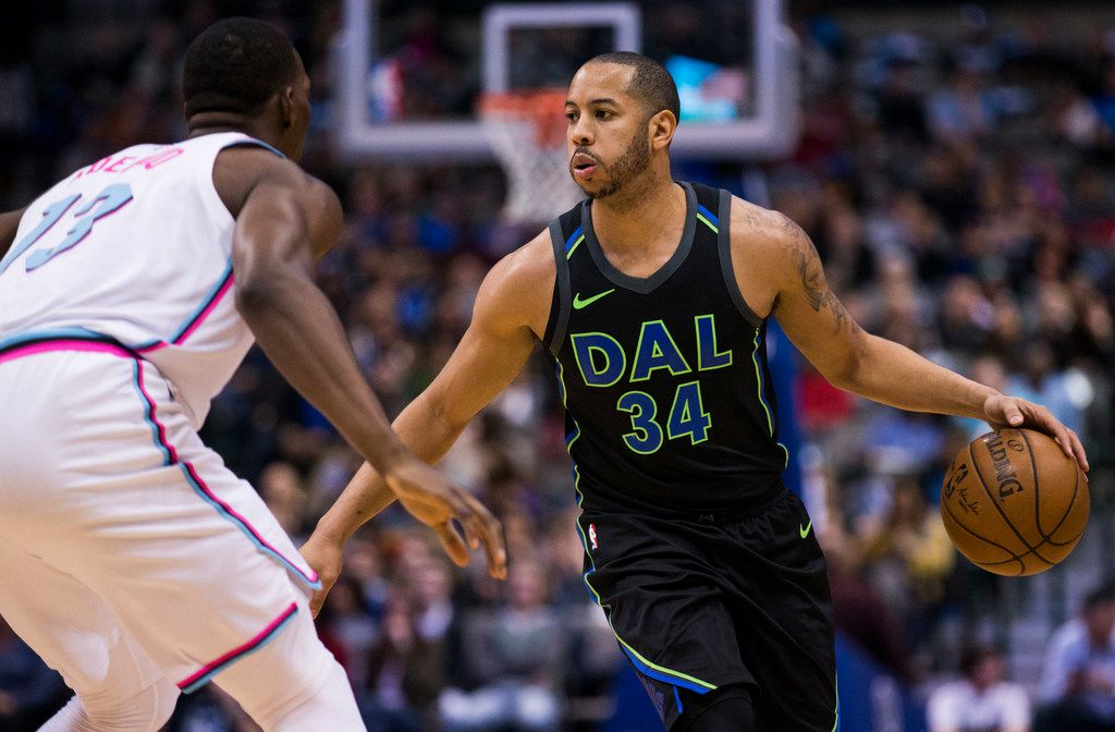Dallas Mavericks guard Devin Harris (34) looks for a pass around Miami Heat center Bam Adebayo (13) during the second quarter of an NBA game between the Dallas Mavericks and the Miami Heat on Monday, January 29, 2018 at American Airlines Center in Dallas. (Ashley Landis/The Dallas Morning News)