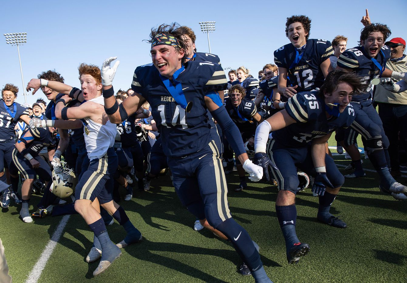 Austin Regents players celebrate after winning a TAPPS Division II state championship game against Dallas Christian in Hewitt on Saturday, Dec. 19, 2020. Austin won with a touchdown in the final second, 26-20.
