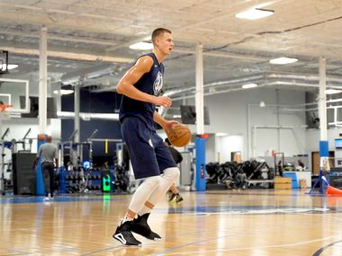Mavericks forward/center Kristaps Porzingis takes shots during the team's first mandatory workout on July 1, 2020. Porzingis and others played at the team's practice facility in Dallas for the first time since the coronavirus pandemic started. (Photo courtesy Dallas Mavericks)